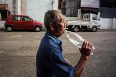 Cooling Off (abd. halim hadi) Tags: man hot chinese drinking off malaysia equinox cooling seniur
