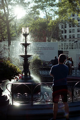 Contemplation (Rafakoy) Tags: park city light summer people urban newyork color film water fountain standing person daylight manhattan scan midtown negative human nikonfe2 c41 2015 fujisuperia100 epsonperfectionv600