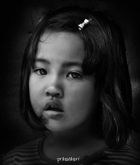 Baby K (akurasai) Tags: portrait blackandwhite girl hair little expression sony sonyalpha sonydslr