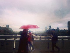 The Red Umbrella (Nassia Kapa) Tags: red rain umbrella londonbridge grey romance thoughts redumbrella londontales takenfrominsideabus nassiakapa