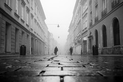 Streets of Krakow (Tommy Høyland) Tags: road street old city morning travel people urban bw white house mist black tourism fog architecture facade buildings walking lights early town photo europe european outdoor pov smoke low poland krakow polish visit cobbled structure historic line cobblestone lane contruction distance residential cracow bnw