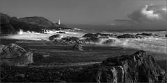 bracelet bay (amazingstoker) Tags: sea lighthouse storm monochrome swansea wales bay rocks waves dusk le bracelet gower mumbles