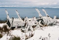 Turned Over (Rachael.Robinson) Tags: winter canada color film beach nature 35mm outside island chairs fujifilm campobello