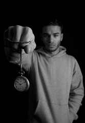 Youth Pocket Watch Hand out (A Greco Photography) Tags: nottingham boy portrait white black home face fashion contrast studio grey hoodie model emotion serious time watch bad chain portraiture pocket tracksuit pocketwatch ganster