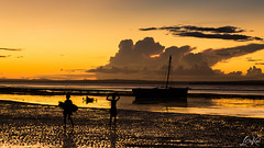 Sea Silhouettes (L.Charl de Klerk) Tags: ocean africa sunset sea people beach water silhouette landscape boat flickr singing outdoor serene firewood mozambique dhow pemba