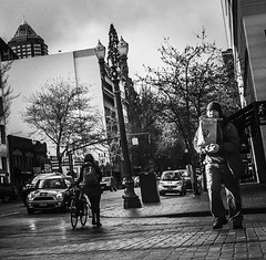 Carriers And Riders (TMimages PDX) Tags: road street city people urban blackandwhite monochrome buildings portland geotagged photography photo image streetphotography streetscene sidewalk photograph pedestrians pacificnorthwest avenue vignette fineartphotography iphoneography