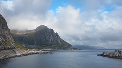 a place so promising that you itch to explore it (lunaryuna (off to Iceland for 2 weeks)) Tags: sea sky mist seascape mountains nature beauty weather norway landscape coast lunaryuna cloudscape islets lofotenislands lowcloud norwegiansea lightmood lofotenwall lofotenarchipelago