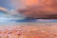 Pastel dramas (Louise Denton) Tags: ocean sunset sea cloud storm water weather rocks darwin shelf eastpoint northernterritory topend wetseason