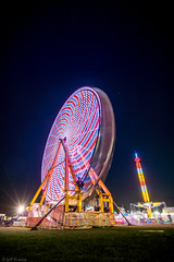 New Smyrna Beach Skyfest - Wheel of Fun (Jeff Krause Photography) Tags: show new beach wheel night plane lights airport ride fairground ferris airshow smyrna skyfest animalted