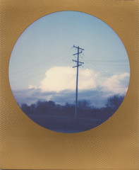 Fresh Air (benjaflynn) Tags: street trees light sunset sky storm nature weather clouds analog rural vintage polaroid outside outdoors evening countryside illinois soft mood dusk antique retro powerlines fade batavia prairie roadside instantcamera pola cloudporn thunderhead expiredfilm roid plasticlens fixedfocus instantfilm 600film thecountry scannedfilm primelens iso640 skyporn insta polalove rurality jobpro2 integralfilm epsonperfectionv500 goldborder theimpossibleproject polaroidjobproii benseidelman impossiblefilm circleframeedition polaroid116mmlens impossiblecircleframe expired1115 millcreekprairiepreserve