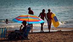 Call It a Day (Haytham M.) Tags: ocean lake beach swim umbrella canon sand outdoor walk float 18200mm swimmingwater t4i