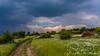 Stormy weather (Milen Mladenov) Tags: 2018 bulgaria landscape montana ogosta ogostareservoir resco clouds daylight daytime field flowers grass light nature park path pole storm trees