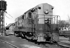New Haven Railroad DERS-3 class FM H16-44 Road Switcher # 562, is seen in the locomotive service area of the yard at Framingham, Massachusetts, February 25, 1951 (alcomike43) Tags: newhavenrailroad newyorknewhavenhartfordrailroadcompany railroads trains freighttrains passengertrains framinghammassachusetts yard locomotiveservicearea tracks siding ties anglebars spikes conventionaljointedsectionrail rightofway sandingtower railroadfacilities fairbanksmorse fm h4416 roadswitcher ders3class 562 592 raymondlowey trainmaster diesel engine locomotive diesellocomotive dieselengine dieselelectriclocomotive photo photograph bw blackandwhite old historic vintage classic