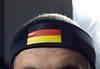 Man wearing head strap with German flag (wuestenigel) Tags: man head flag germany strap football fan soccer worldcup people menschen lid mitglied portrait porträt mann girl mädchen veil schleier adult erwachsene wear tragen fusball one ein safety sicherheit woman frau helmet helm fashion mode competition wettbewerb flagge athlete athlet cap kappe studio model modell