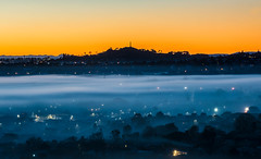 City under siege from fog (jimkilgallon) Tags: dawn sunrise atmosphere auckland mt albert one tree hill orange fog mist new zealand urban winter west mysterious