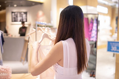 Young woman shopping in shopping mall in Singapore (Apricot Cafe) Tags: img94339 asia asianandindianethnicities chineseethnicity clarkequay healthylifestyle singapore tamronsp35mmf18divcusdmodelf012 carefree clothing colorimage consumerism copyspace dress happiness indoors leisureactivity lifestyles longhair oneperson oneyoungwomanonly people photography realpeople rearview shopping shoppingmall sleeveless smiling straighthair waistup weekendactivities whitedress women youngadult sg