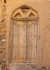 Omani wooden carved door, Ad Dakhiliyah Region, Al Hamra, Oman (Eric Lafforgue) Tags: abandoned abandonedhouse alhamra arabesque arabia arabianpeninsula arabicstyle architecture buildingentrance builtstructure carved colorimage cultures day decrepit door entrance facade gulfcountries habitation history house housing nopeople oldhouse oldtown oman oman18073 omani ornate outdoors ruin ruins sultanate thepast traveldestination traveldestinations vertical weathered wood woodmaterial woodendoor addakhiliyahregion om