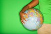 Stock Images (perfectionistreviews) Tags: 1012years kid child female girl onepersononly photograph color africanamerican preteen studioshot indoors portrait studio horizontal world holding map education geography earth globe carrying arm hand hip bodypart copyspace green lifestyle leisure student school person