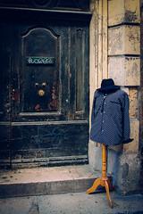 Arles, France - Man at the Door (Regan Gilder) Tags: arles france southoffrance languedocroussillon eu europe canon canoneos5dmarkiii street shirt hat door doorhandle