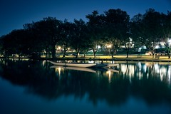 Floating (fool's itch) Tags: night lights trees river landscape blue longexposure reflectionsinthewater reflection rowboats boats boat nikon tranquil peaceful serene