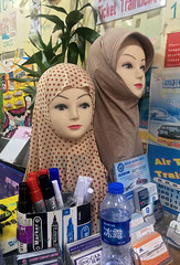 Train Ticket Booth (cowyeow) Tags: street funny funnychina asia asian guangdong china chinese mannequin dummy odd weird heads women girls hijab clothing apparel fashion shop guangzhou tickets ticketbooth booth desk