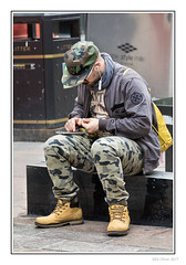 Mr Multitasker (Seven_Wishes) Tags: glasgow streetphotography canoneos5dmarkiv canonef70200mmf28lisii outdoor photoborder kc jo hm gs streetportrait candid sitting mobilephone cellphone rollie tobacco rollingacigarette cap boots glams combats people portrait edoliverphotography 2017 views8k
