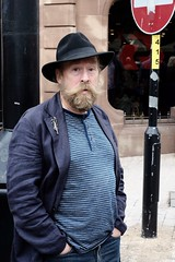 Yes I did. (ianmiller6771) Tags: ukstreetphotography beard man hat blue expression fuji aggressive surly brooch surprise pointblank silverbrooch jewellery