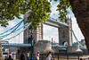 Tower Bridge - London (Keith in Exeter) Tags: tower bridge london capital city england building iconic famous architecture fence river water streetlight bus people tree leaves foliage londonplane flag tourist tourism landmark
