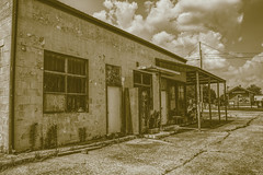 Stonefort, IL 01 (Christopher Elliot Taylor) Tags: 2452 outdoors building historic old canont1i affinityphoto smalltownusa hdr tonemapping dog girl sepia stonefortillinois southernillinois illinois monochrome