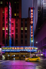 Radio City (GeraldGrote) Tags: night usa musichall taxi manhattan street city cab newyork neon radiocity light us