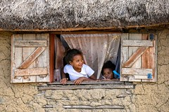 Calling Friends (Rod Waddington) Tags: africa african afrique afrika madagascar malagasy girls house window shutters thatch outdoor culture cultural children ethnic ethnicity building