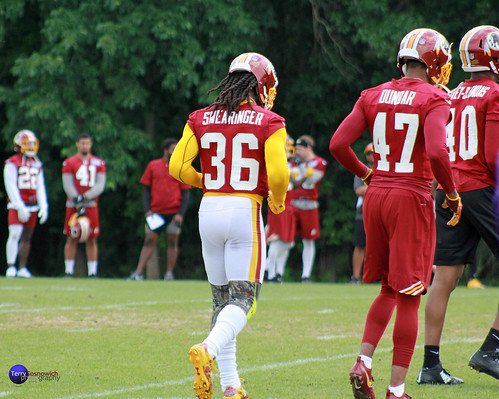 Redskins safety DJ Swearinger Sr. (36) and CB Quinton Dunbar (47) run onto field.