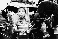 Propeller (Meljoe San Diego) Tags: meljoesandiego ricoh grd4 grdiv streetphotography toy tricycle candid monochrome philippines