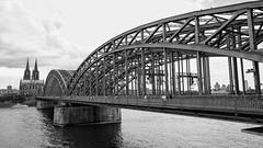 Cologne... (John Konstandis) Tags: canoneos5dmarkiii canonef1635mmf4lisusm blackandwhitephotography blackwhite monochrome bridge water river cologne dom rhine