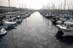 Brighton Marina / Canon AE-1 / Ilford Delta 3200 (rob orchard) Tags: brighton marina canon ae1 ilford delta 3200 film 35mm analog analogue monochrome boats