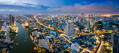 Aerial view of Bangkok skyline and skyscraper with BTS skytrain Bangkok downtown. Panorama of Sathorn and Silom business district Bangkok Thailand at night. (MongkolChuewong) Tags: aerial aerialview apartment architecture asia bangkok bank blue bridge bts building business capital chaophrayariver city cityscape condo condominium day district downtown drone grass high hotel light metropolis modern night office reflection residence river roof sathorn shadow silom skyline skyscrapers skytrain sunrise sunset taksin thai thailand top tower town travel urban vertical view water waterfront windows krungthepmahanakhon th