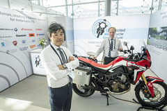Tomohiro Matsuda at the Connected Motorcycle Consortium stand
