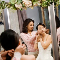 Stock Images (perfectionistreviews) Tags: square indoors color image photograph twopeople women woman female 2530years africanamerican asian chinese youngadult occasion bride weddingdress bridal humanrelationship friend girlfriend friendship preparation preparing prepare activity dress mirror reflection assist style shopping shop necklace jewelry fashion salesperson earring earrings pretty attractive beautiful beauty wedding halflength anticipation attire apparel clothes costume clothing marriage gown holidaysandoccasions