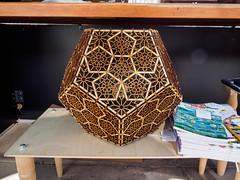 Dodcahedron (mount_evans) Tags: olympus omd em5 microfourthirds mzuiko1250mmf3563 existinglight outdoor longmont colorado tinkermill fourthofjuly carnival regulardodcahedron platonicsolid lasercut wood