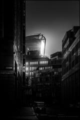 The Walkie Talkie building (G. Postlethwaite esq.) Tags: bw london sonya7mkii blackandwhite buildings cars mirrorless monochrome photoborder street sunset windows