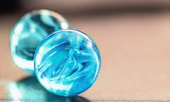 true blue (Vanessa away on vacay) Tags: 90mm macro marbles glass glassmenagerie toys blue