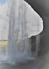Behind the waterfall, Iceland (Ian@NZFlickr) Tags: seljalandsfoss the waterfall drops 60 m 197 ft is part seljalands river that has its origin volcano glacier eyjafjallajökull3 visitors can walk behind falls small cave wikipedia