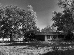 Abandoned but not forgotten (John Ilko) Tags: 500px abandoned palmettofl us41 forsale property fujifilm 18mm monochromer house oldbuilding oldstructure