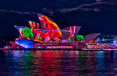Jaws and straws (JustAddVignette) Tags: australia circularquay city cityscape clouds colours landscapes lightfestival lights newsouthwales night nightscape ocean reflections seawater sky sydney sydneycbd vivid vivid2018 vividsydney water