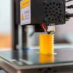 3D printer printing a yellow piece thumbnail