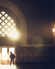 A woman walking through a door of Los Angeles Union Station on a beautiful backlit sunset with some lens flare. (pedferr) Tags: sunny color cinematic inside retro moody lowlight 4x5 orange door female california unitedstatesofamerica woman intense antique station dramatic lines usa lensflare building sunset old vertical vintage mystic wall walking sun urban colorful classic silhouette shapes backlight pattern sunrise morning interior warm lifestyle column