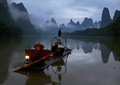 Cormorant Fisherman, China (charlottebrettphotography) Tags: asiantravel asia guangxiprovince landscapephotography travelphotography travel landscapesoftheworld guangxi liriver cormorantfisherman guilin china
