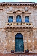 Maltese Doors (Douguerreotype) Tags: window city historic symmetry balcony buildings malta architecture urban door