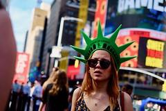 Lady Liberty (dangaken) Tags: nyc newyorkny newyorknewyork ny empirestate bigapple usa unitedstates us america summer city urban timessquare statueofliberty foam hat redhead blonde street candid fuji fujiflim xmount freckles foamhat libertytaxservice dgaken dangaken photobydangaken