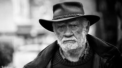 I don't like Poetry (Neil. Moralee) Tags: neilmoralee farmer farm man old mature hat face portrait close beard street candid minehead somerset neil moralee nikon d7200 black white bw bandw mono monochrome stern stare eye eyes husband rural work blackandwhite poetry pragmatic strong determined